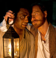 Photo of Chiwetel Ejiofar and Michael Fassbender in 12 Years a Slave. Photo credit.
