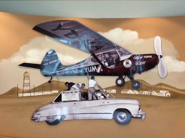 Artwork hanging in Yuma's City Hall that depicts how the crews refueled the airplane during its endurance flight.